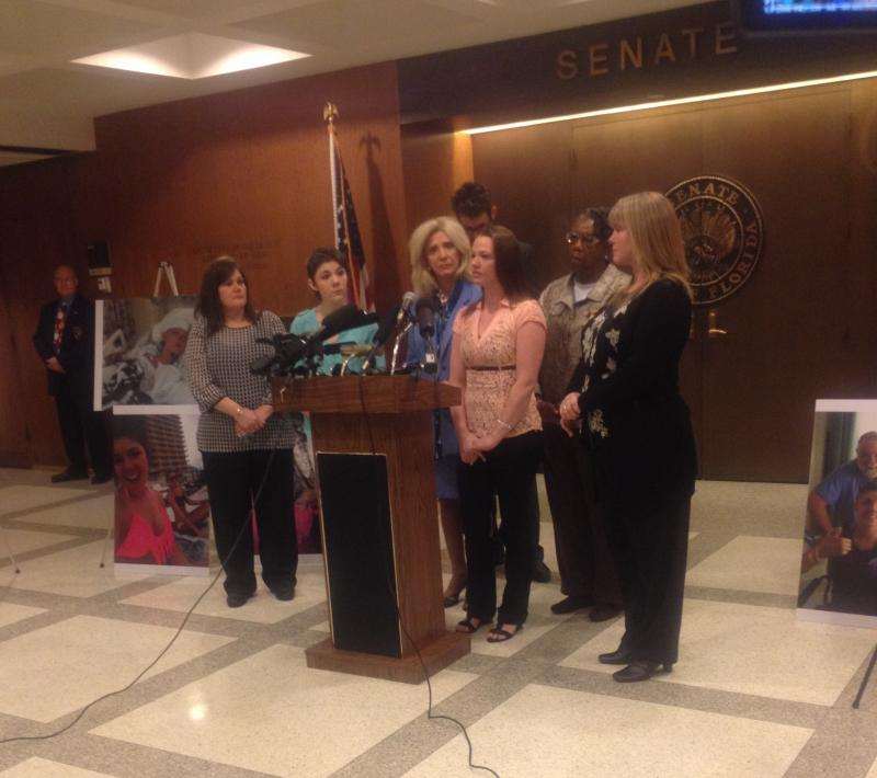 Crystal White is speaking at a news conference Thursday, recalling her parasailing accident, which left her with permanent brain damage and her sister dead. She's surrounded by her mother (far left), Alexis Fairchild and her mother, and lawmakers.