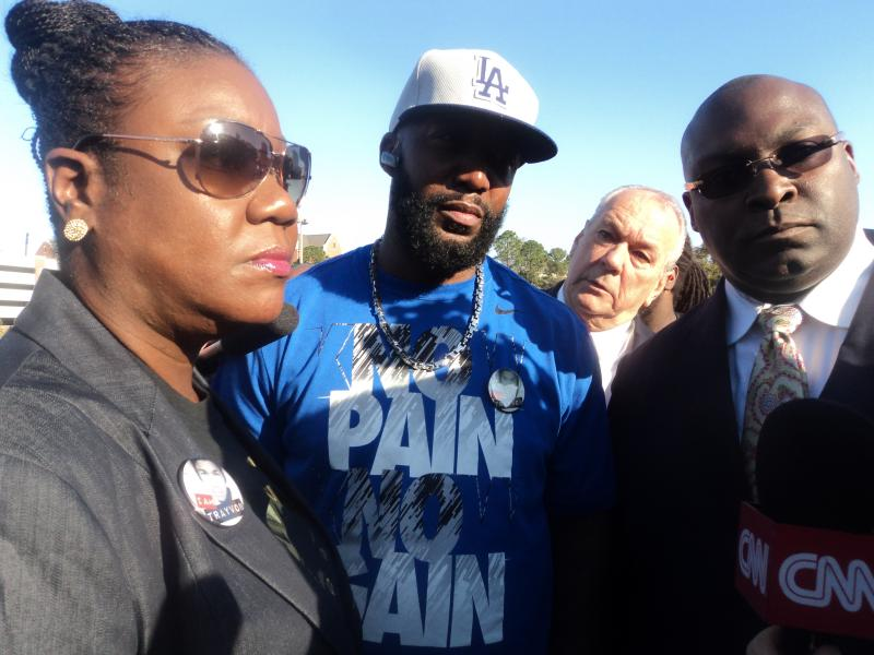 Sybrina Fulton and Tracy Martin, the parents of Trayvon Martin, joined by one of their attorneys, Daryl Parks, before the start of the march.
