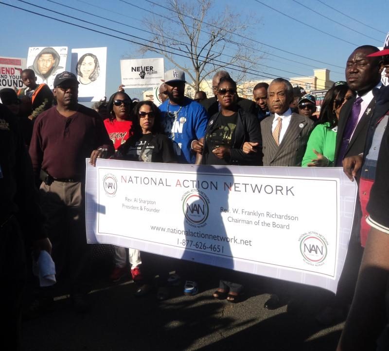 Rev. Al Sharpton joined by the parents of slain teens, Trayvon Martin and Jordan Davis, as well as hundreds of protestors, at a march to the State Capitol building Monday.