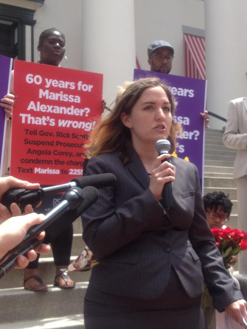 Melissa Byrne, a member of UltraViolet, speaking to reporters at the rally.