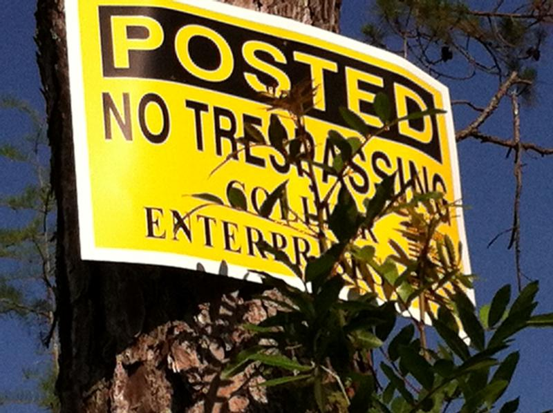 This sign at the edge of Golden Gate Estates warns residents the field it straddles is private property