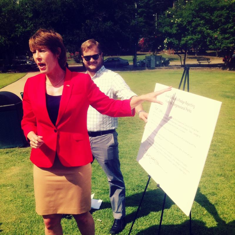 Gwen Graham signed a pledge to reject government perks at Lake Ella Thursday.