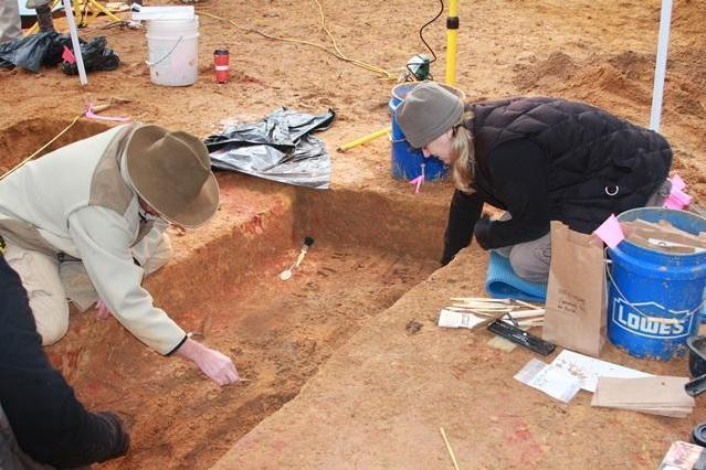 Lead USF researcher Erin Kimmerle and her team working on an unmarked grave.
