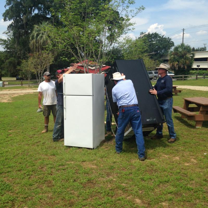 men moving fridges