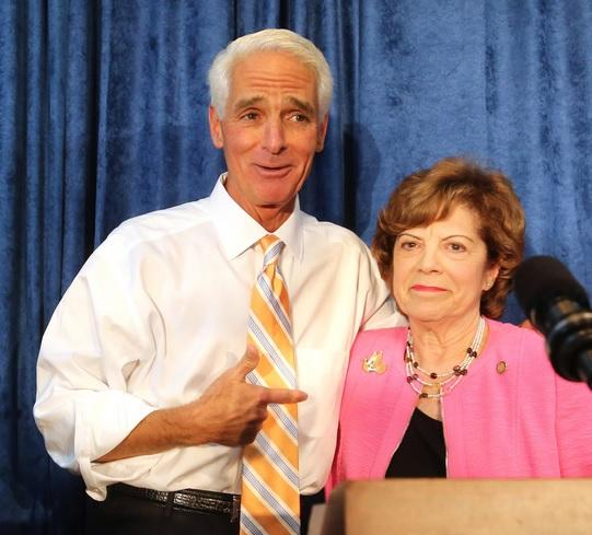Democratic gubernatorial nominee Charlie Crist embraces his former primary opponent, Nan Rich, during a party unity rally in Orlando, Aug. 28, 2014.