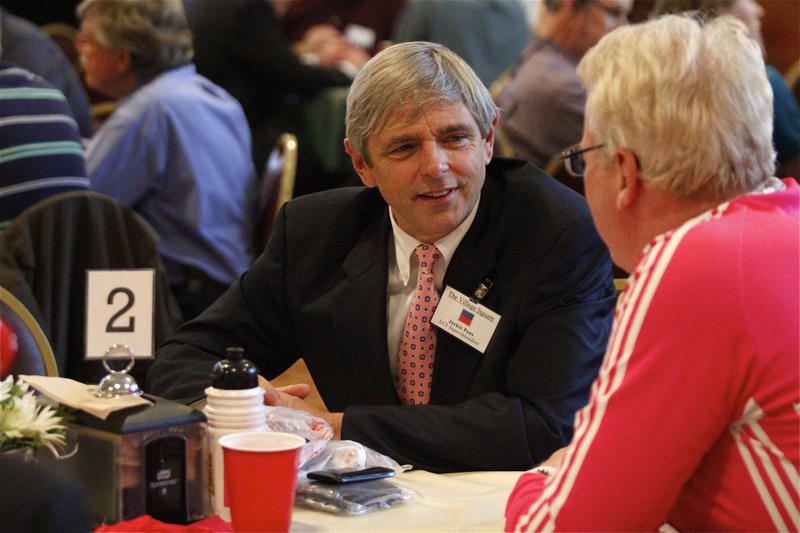 Jackie Pons speaking with a constituent at a Village Square event in 2013.