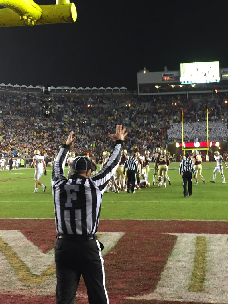 The field judge puts his hands up signaling Florida State's final field goal try is good.  Florida State beat Boston College 20-17.
