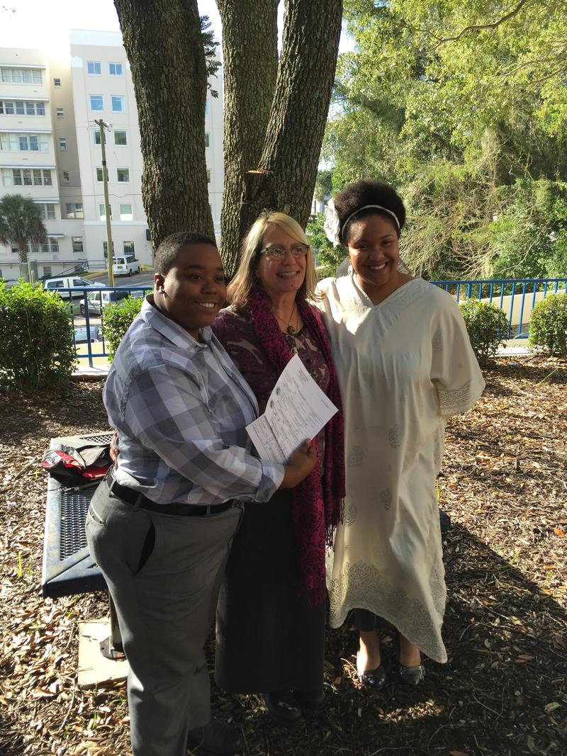 (L-R) Ayana Powell, their officiant and Rochelle Cornwall