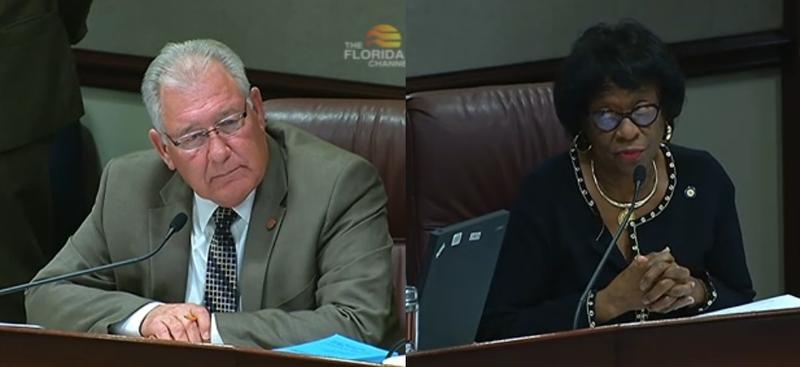 Sen. Greg Evers (R-Baker) listening to Senate Democratic Leader Arthenia Joyner on her thoughts on his omnibus prison reform bill Wednesday..