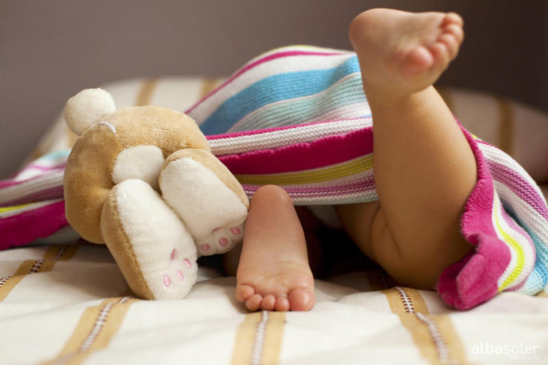 baby feet and stuffed bunny feet in photo