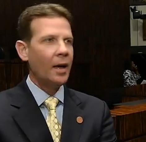 Senate President Andy Gardiner talks to reporters.