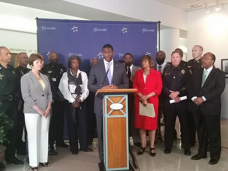 Mayor Andrew Gillum (center) with City Commissioner Nancy Miller (left), City Manager Anita Favors-Thompson (right) and City Commissioner Curis Richardson (far left), Leon Sheriff mike Wood and Deputy Police Chief Darrell Furuseth talk crime in Tallahasse