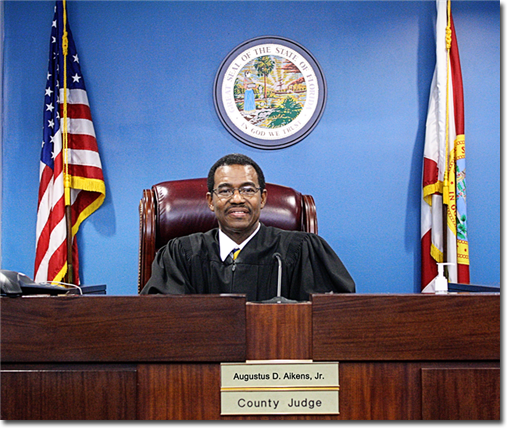 Judge Aikens sits in his Leon County Courtroom