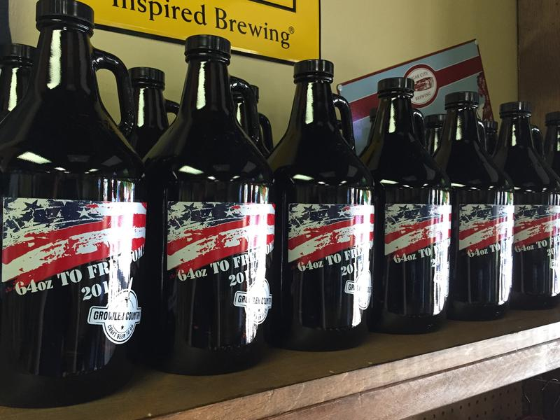 Finally legal to fill, 64 ounce growlers line the walls.