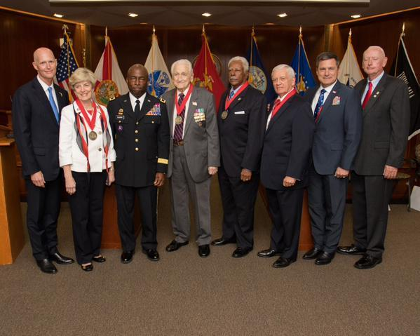 L-R Gov. Scott; Jane Collins, wife of the late Rear Adm. LeRoy Collins Jr,; Maj. Gen. Michael A. Calhoun; Lt. Gen. Lawrence F. Snowden; Chief Master Sgt. Eugene Cecil Johnson; Col. Harry Frank Farmer Jr.; Dept. of Veterans Affairs Director Mike Prendergra