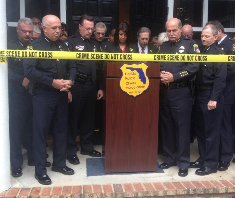 Members of the Florida Police Chiefs Association hold a moment of silence for fallen law enforcement officers Thursday, before an unveiling of their latest headquarters in Tallahassee.