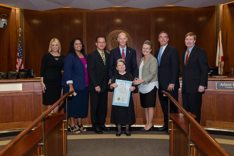 Stacia Woolverton (middle) spoke during the Florida Cabinet's commemoration of Disability Employment Awareness Month Tuesday.