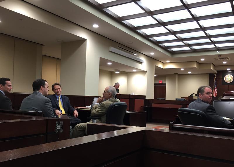 Attorneys huddling ahead of Friday's hearing.