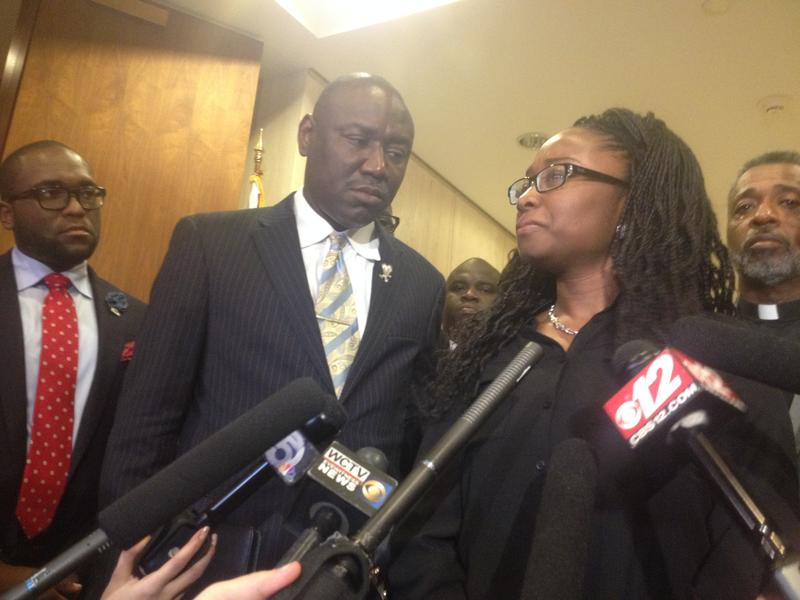 Melissa, Corey Jones' sister, is getting ready to speak to reporters, while Rep. Shevrin Jones (D-West Park)[far left], the sponsor of the body cameras bill, Tallahassee Attorney Benjamin Crump, representing the family, and her father, Clinton, look on.