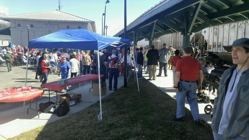 A crowd gathers to greet Amtrak officials as the company explores restoring passenger service to North Florida