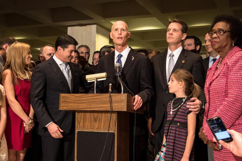 Governor Scott flanked by House Speaker Steve Crisafulli (left) Senate President Andy Gardiner (right) and Senate Minority Leader Arthenia Joyner (far right).