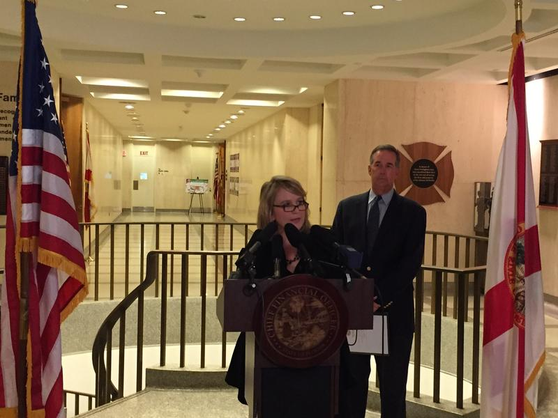FCADV President Tiffany Carr flanked by CFO Jeff Atwater.