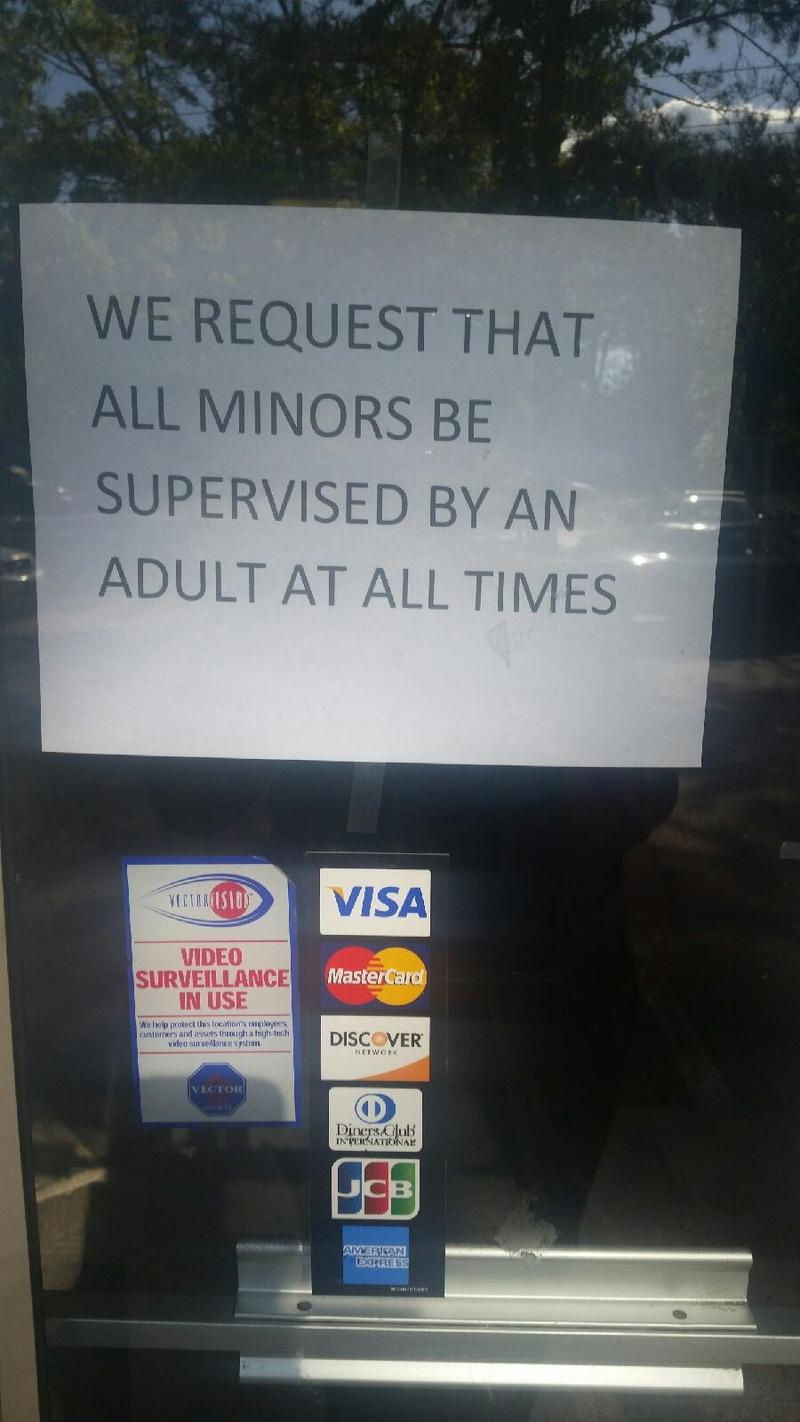This sign is on the front door of Good Samaritan's thrift store on Woodville Highway