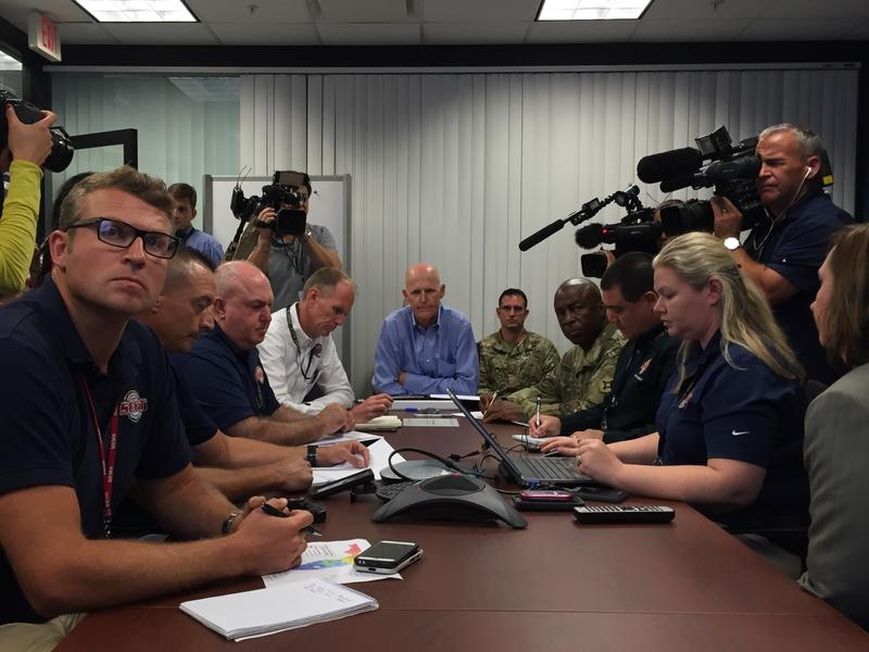 Gov. Scott (center) with emergency officials being briefed on Tropical Storm Colin Monday morning.