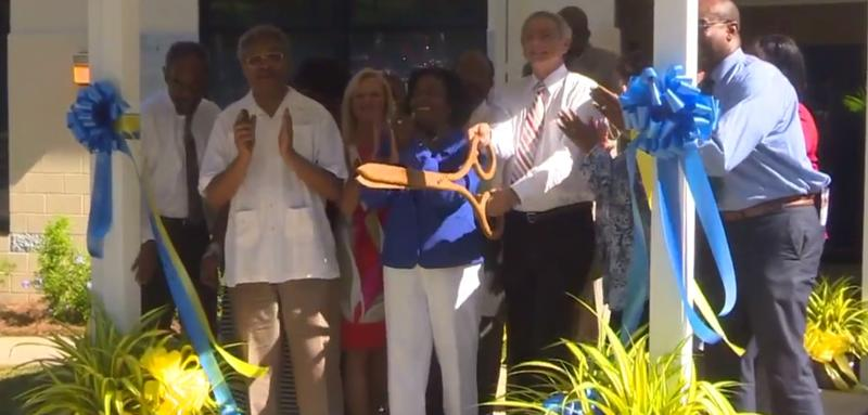 Local school and health representatives cut the ribbon on Neighborhood Health Center's Rickards location in June.