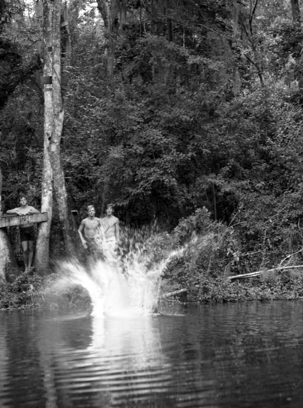 View of young people jumping into Horn Spring - Leon County, Florida. (1969)