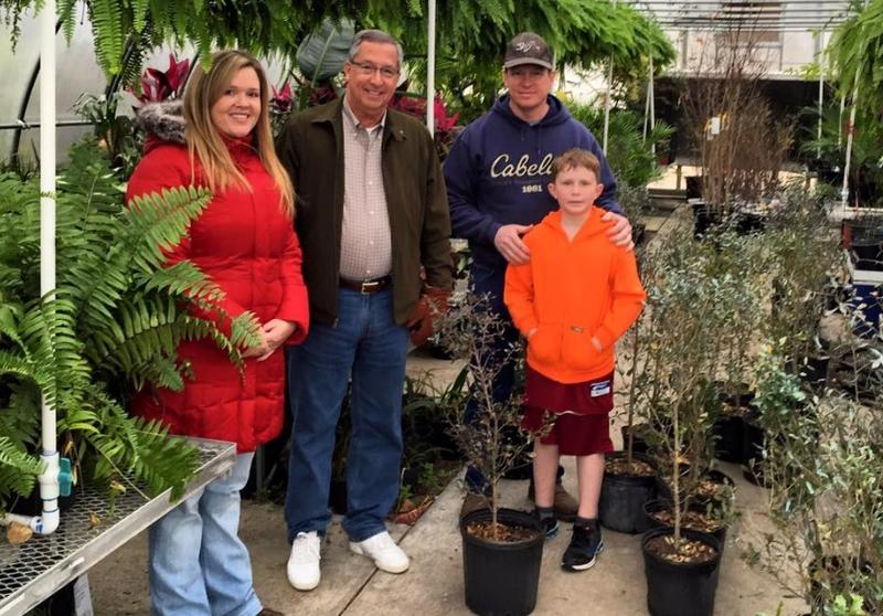 Some Valdosta Tree Commissioners with a customer picking up trees during the Tree Sale earilier this year at Wiregrass Georgia Tech's Horticulture.