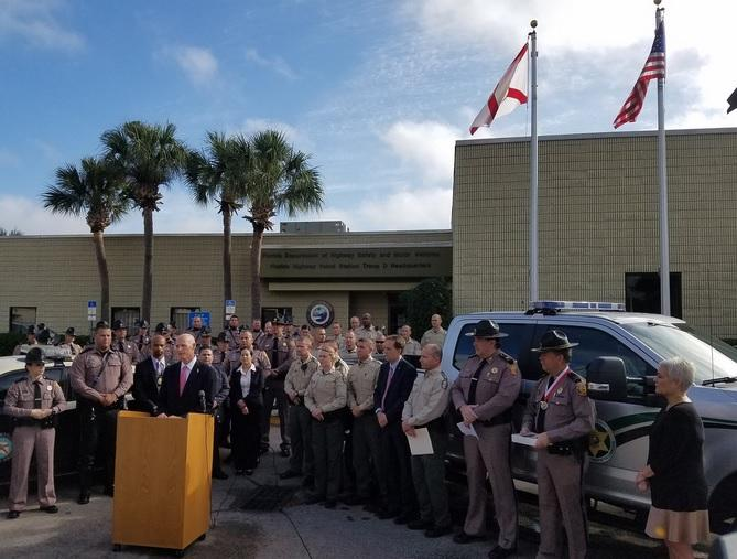 Surrounded by different law enforcement agencies in Orlando, Governor Rick Scott announced a proposed pay raise for law enforcement officers.