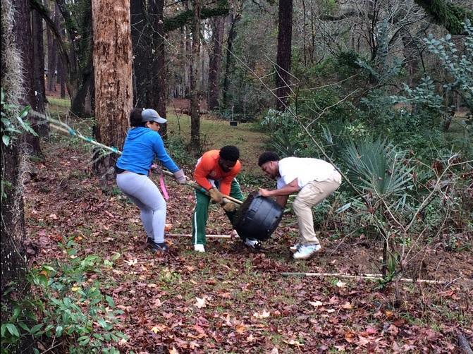 Volunteers planting trees at Lafayette Park on Saturday.