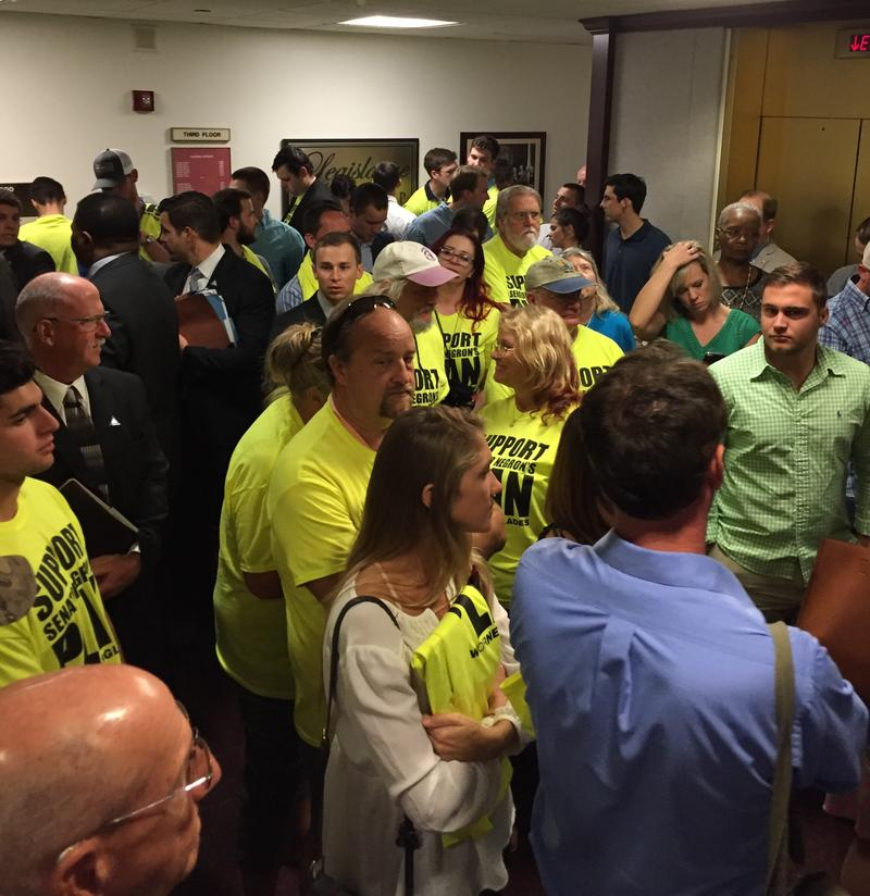 The crowd waiting for the hearing.