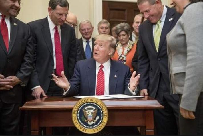 National Association of Counties President and Leon County Commissioner Bryan Desloge (left) along with other county leaders at President Trump's Executive Order signing ceremony in March.