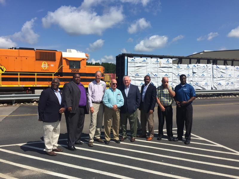 Rep. Alexander and Sen. Montford (3rd and 4th from right) with local officials.