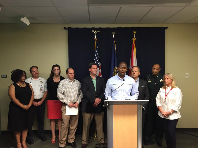 Mayor Andrew Gillum flanked by city and county officials, including John Dailey (left) speaking about Hurricane Irma prep.