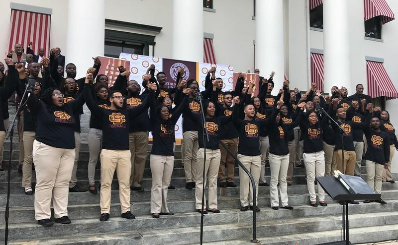 "On the steps of the Old Florida Capitol building, the B-CU Concert Chorale sing ""Lift Every Voice and Sing,"" the black national anthem."