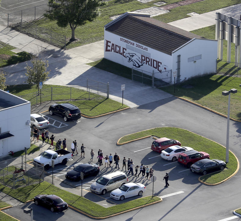 Students are evacuated from Marjory Stoneman Douglas High School on Wednesday, after a gunman opened fire and killed 17 people.