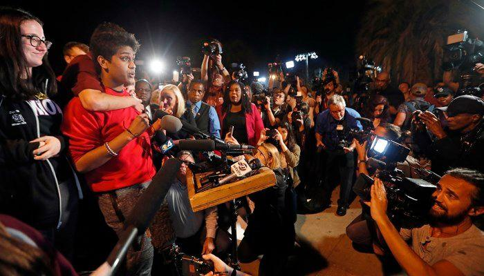 Tanzil Philip, 16, a student survivor from Marjory Stoneman Douglas High Schoo; speaks to a crowd of supporters and media at Leon High School, in Tallahassee, Fla.