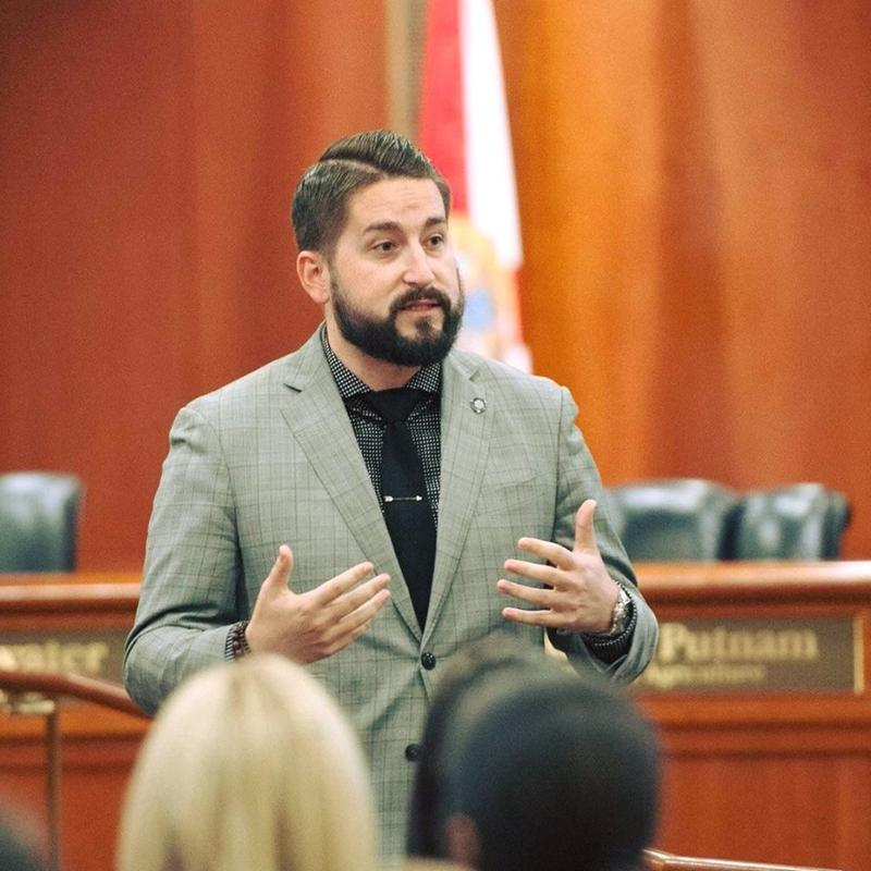 Dustin Daniels speaks in the Tallahassee City Commission Chamber (undated)