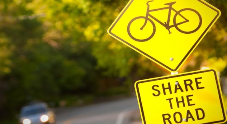 "The sign with a bicycle also says ""share the road."""