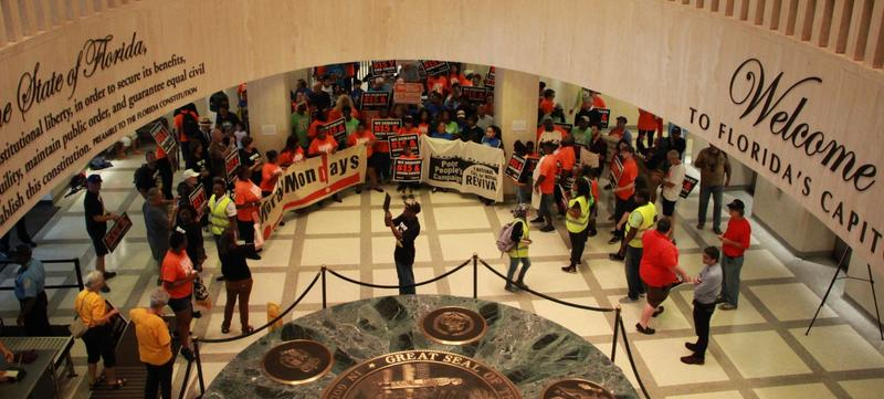 Groups gathered in the Florida Capitol, wearing orange, to call for higher minimum wage in the state.