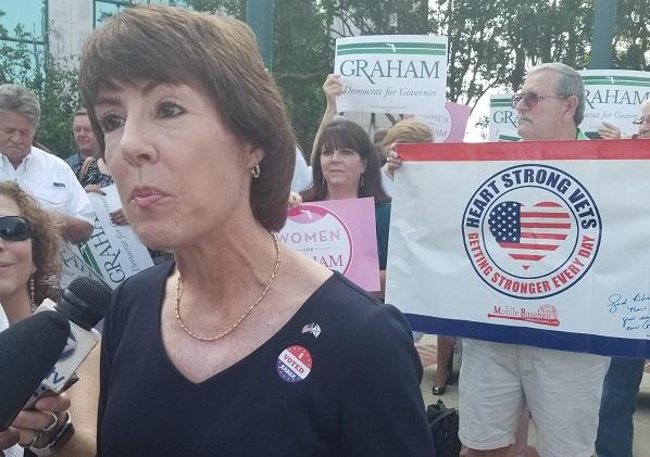 Gwen Graham speaks with reporters outside the Leon County Courthouse Thursday. Graham is on the last leg of her campaign ahead of the Tuesday primary. (8/23/2018)