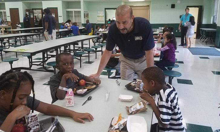Leon County Schools Superintendent Rocky Hanna speaking with Bond Elementary school students during lunch.