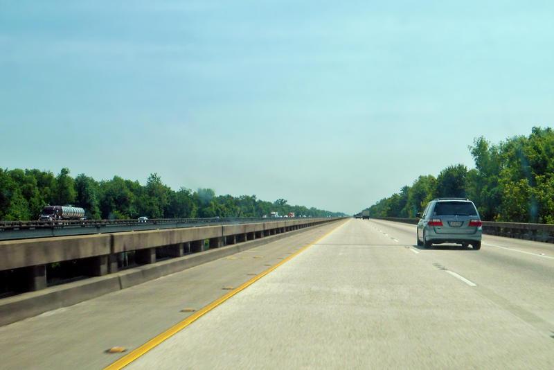 car on highway bridge