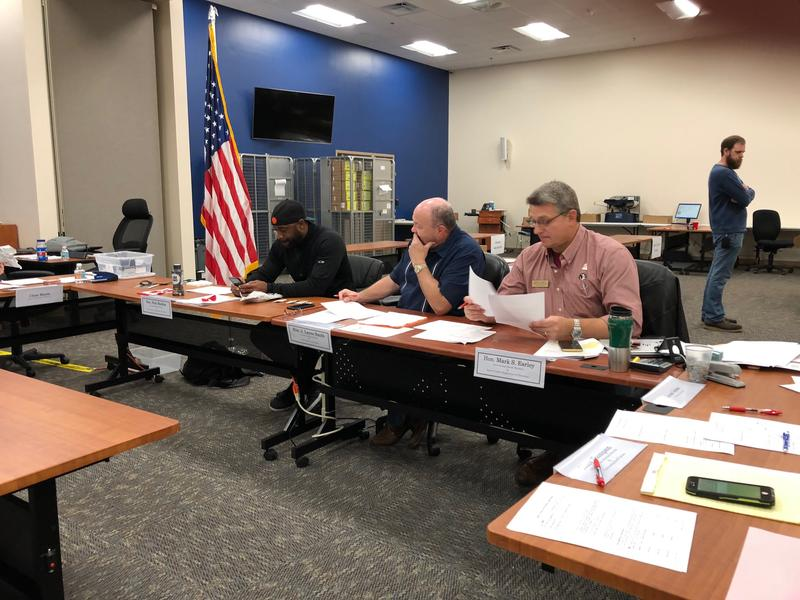 County commissioner Nick Maddox (l), Leon County Judge Lane Smith (c) and Supervisor of Elections Mark Earley (r) make up the county canvassing board and are evaluating questionable ballots