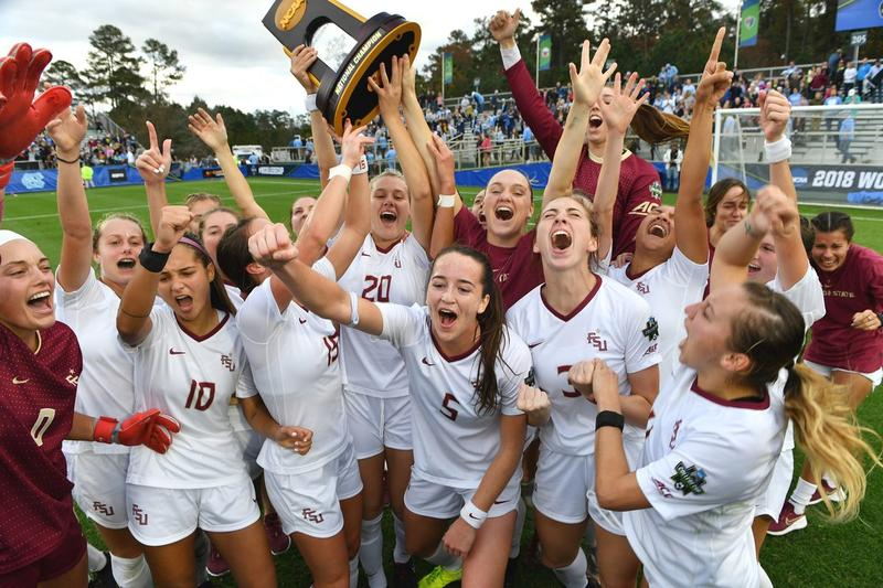 The FSU Soccer team celebrates with their trophy after winning the 2018 National Championship title.