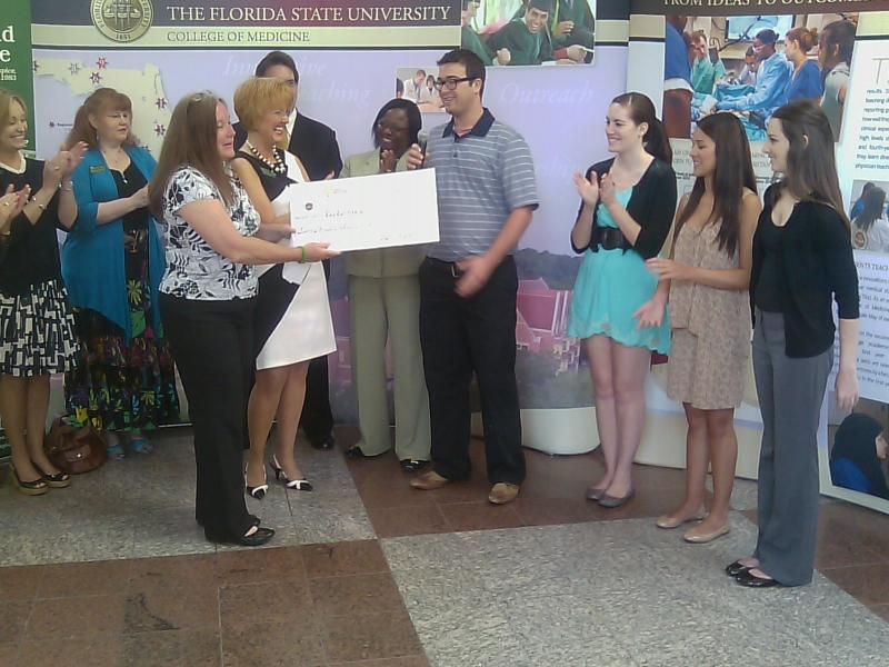 FSU students present Big Bend Hospice with a check for $20,000.