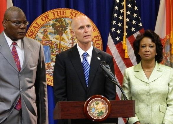 "Tallahassee's Rev. R.B. Holmes (left) joins Gov. Rick Scott (center) and Lt. Gov. Jennifer Carroll (right) in announcing a task force to look into the ""Stand Your Ground"" law"